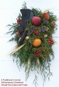 A traditional Colonial Williamsburg Christmas wreath decorated with fruits