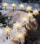 Line the pathway with 'snowflake' or 'star-shaped' lights available in most stores.
